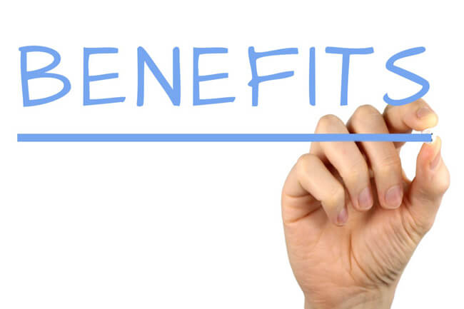 A photo of a hand writing the word Benefits