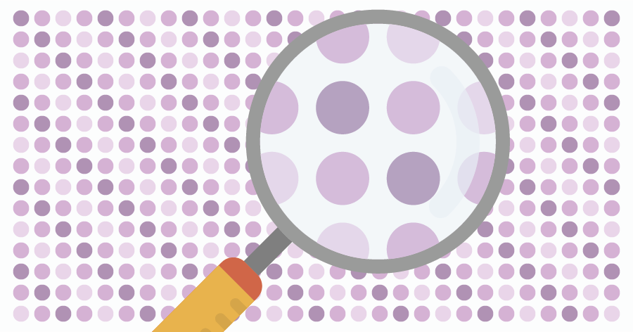 An illustration of a grid of dots being partly magnified by a magnifying lens